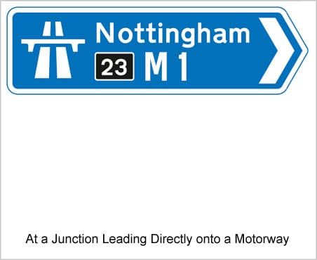 UK Road Signs At a Junction Leading Directly Onto a Motorway